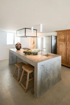 a simple concrete kitchen island with a breakfast space is also an industrial id… - Kitchen - Best Kitchen Decor!
