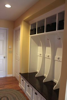 cabinets above mudroom bench. And the dark bench topper would add color to the hall without paint :)