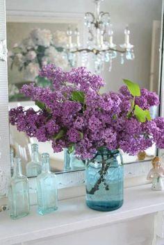 Lavender lilacs in a blue mason jar