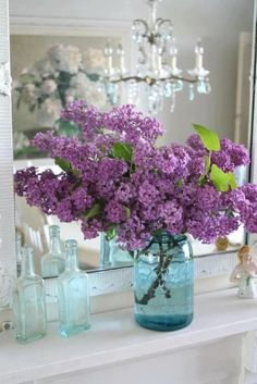 Lavender lilacs in a blue mason jar