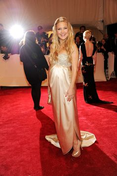 Kate Hudson Evening Dress  Kate Hudson showed off her growing baby bump in a satin champagne strapless gown. Gemstone detailing embellished the bodice of her dress.   Brand: Stella McCartney   Kate Hudson Hair Pin  topped her long blond curls with an antique diamond star.   Brand: Fred Leighton  Kate Hudson Long Wavy Cut  opted for a long tousled waves . A sparkling hair pin was perfectly placed to top off her look