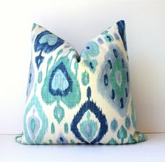 Turquoise and Blue Ikat Designer Cushion Cover 18 Accent Pillow suzani damask cream teal sea foam green wedgewood navy. $40.00, via Etsy.
