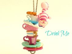 Drink Me Necklace Alice In Wonderland Cheshire cat made it to the top on Stacked teacup