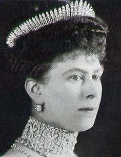 Queen Mary in 1912, wearing the Hanover fringe tiara identified as Queen Adelaide's fringe necklace, also worn by Queen Alexandra. It was also worn by Queen Elizabeth (Queen Mother) as a necklace.