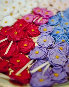 Handmade fabric flowers attached to pins with ribbon for wedding guest to wear