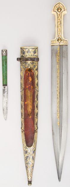 Caucasian qama / kindjal ), 1856–57, 1861, steel, bone, silver, gold, shark skin, ivory, niello, iron, L. with sheath 19 1/4 in. (48.9 cm); L. without sheath 19 1/16 in. (48.4 cm); L. of blade 14 3/4 in. Wt. 12.8 oz. (362.9 g), Met Museum.