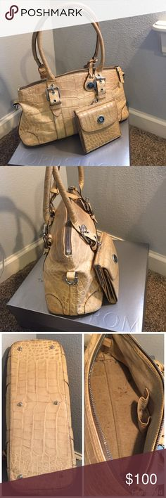 """DOONEY & BOURKE Embossed Croc Leather Handbag DOONEY & BOURKE Tan/Caramel Embossed Crocodile Leather Pre-owned in LIKE NEW condition ( markings inside the bag) Leather body and trim Silvertone hardware Approx measurements:  H 8"""", L 15"""", D 6.5"""", W 5"""" Strap drop 6.5"""" - 8.5"""" adjustable Elegant signature handbag charm attached Interior one zip pocket Interior one key-finder strap Bottom feet to protect and keep bag upright when set down. The purse handles are creasing. (Still in great condition)…"""