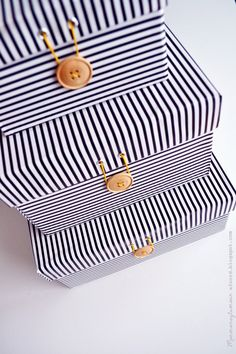 DIY Upcycle your shoeboxes into gorgeous storage boxes.  These instructions are for paper, but fabric would be nice, too.