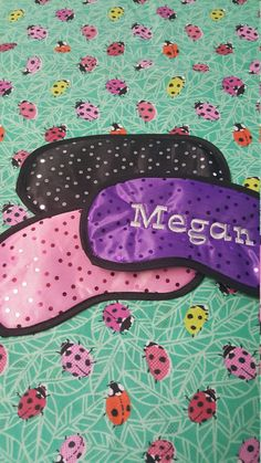 Personalized sequin sleep eye mask embroidered with name.