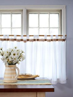 Cafe curtains let the light shine   Set a happy mood in the kitchen with sheer white cafe curtains that welcome natural light while providing just the right amount of privacy.