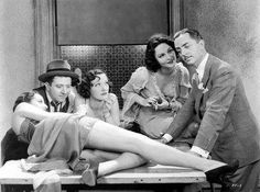 William Powell and Frank McHugh with some beauties.