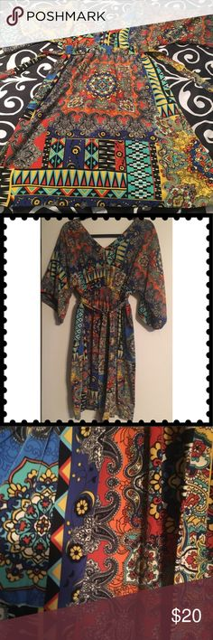 Cute colorful Tunic. Super cute colorful Tunic. EUC   Has elastic waistband and tie in the back. Tops Tunics