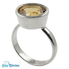 "When the small says it all! This silver jewellery ring with tiny citrine stone in the middle makes a huge wave of impression. This cute tiny ring is the perfect description of the saying, ""It's the little thing that counts!"" Sky Divine 