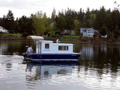 Tiny house...boat. This guy is a really famous boat builder. Such a great design for a small cruiser houseboat