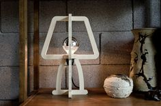 A simple wooden lamp that looks like an outline of a lamp, as if it has been traced on wood, cut out, and put together to create the three-dimensional lamp. Modular Furniture, Cool Furniture, Lamp Design, Wood Design, Cnc, Handmade Lamps, Steampunk Lamp, Wooden Lamp, Modern Lighting
