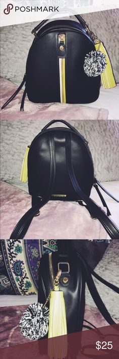 Steve Madden Trendy Backpack The perfect size Backpack for small travels. If you're spending a day in the city and don't want to carry a purse, this is the perfect alternative! Black small backpack with lime green and white zipper in the front. Gold zipper handles & small keychains to go with. Gently used TWICE (I have many bags). No stains, tears, or rips. In perfect condition. Adjustable straps. Has a handle on top, if you want to carry as well. Fits wallets, keys, lotion, makeup, etc…