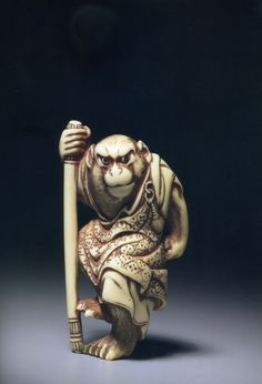 An Iconic Netsuke of Songuku returning from his travels