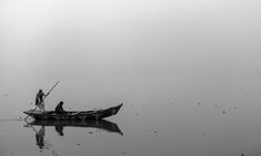 Rowing a boat in a foggy Chenab. Punjab Village Pakistan
