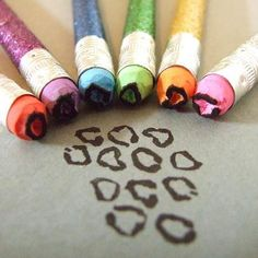 Sharpen the eraser of a pencil and dip them in nail polish and it looks like cheetah prints!!!
