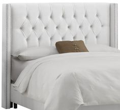 Diamond Tufted  King Headboard. Perhaps my headboard can be covered like this?