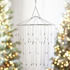 Coat hanger creativity on pinterest 131 pins for Hanging ornaments from chandelier