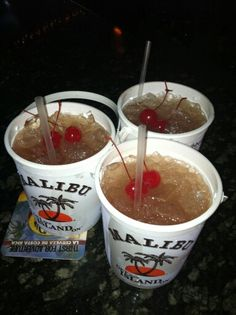 The famous Voodoo Bucket, ingredients: a shot of every flavor of Malibu, pineapple juice and fruit punch. Enjoy :)