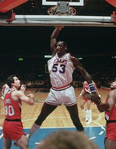 """Darryl Dawkins dunks during the 76ers game against the Trail Blazers on Jan. 16, 1980 at the Spectrum inPhiladelphia. A 6'11"""" center, Dawkins earned the nickname """"Chocolate Thunder"""" during his playing days for his high-flying, powerful dunks. He famously broke two backboards in 1979. Dawkins has passed away at age 58.(Manny Millan for SI)GALLERY: SI's Best Photos of Darryl Dawkins"""