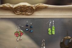 Create artwork for your bathroom or closet with easy access to all your earrings