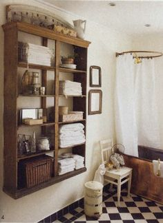 Bathroom Storage Idea - a large hutch top, with its doors removed, is attached to the wall. This is a brilliant way use what you have to create storage!!!