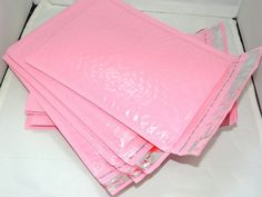 P A C K A G I N G This is a 100 Pack of Pastel Pink Poly bubble mailers in the standard size Acn