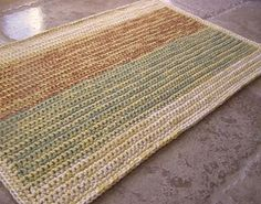 ravelry.com  Worked with 2 strands.  Crochet this quick easy rug and bust your stash of leftover worsted weight yarn! Sample shown is acrylic, but you could use cotton for a heavier rug.