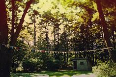 Bunting in the woods....beautiful (don't miss the rest of the wedding pics on this page...amazing!) #wedding #bunting #garland #trees #woods #reception #ceremony #decor #garland #flags