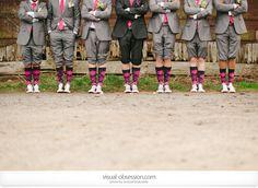 Groom wearing black.   socks!