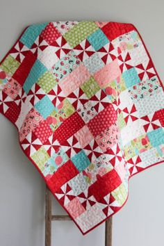 Such a pretty quilt! The quilt pattern was designed by Cluck, Cluck Sew and was handmade and machine quilted by Quilt Baby, Lap Quilts, Scrappy Quilts, Small Quilts, Mini Quilts, Quilt Blocks, Pinwheel Quilt Pattern, Baby Quilt Patterns, Quilt Making