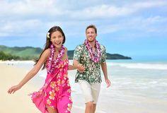Happy couple having fun running on hawaii beach vacations in hawaiian clothing wearing aloha shirt and pink sarong sun dress and flower leis for traditional Hawaii Honeymoon, Best Honeymoon, Hawaii Vacation, Hawaii Travel, Beach Vacations, Cruise Travel, Family Vacations, Vacation Ideas, Bffs