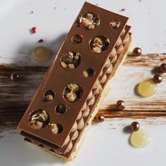 Chestnut Mille Feuille: Inspired from the winter season's all-star ingredient this delicate dessert is filled with contrasting textures and light flavours: a meringue based cake with crunchy praline milk chocolate shards and Japanese chestnut. by jaso Layered Desserts, Fall Desserts, Delicious Desserts, Dessert Recipes, Chocolate Covered Pretzels, French Pastries, Fancy Cakes, Macaron, Plated Desserts