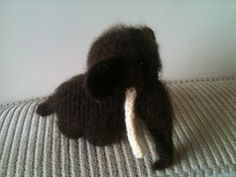 Wooly Mammoth Pattern: Inspired by the mammoths of Skyrim :-D I use a chunky weight alpaca wool and a 5mm crochet hook, then brush all the head and body all over when I'm done to make him extra...