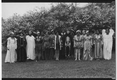 A group of students (from Bennett College) pose outdoors wearing various Halloween costumes, circa 1941.