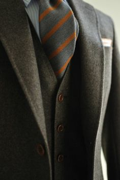 grey, well tailored Single Breasted suit