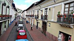 Narrow streets lined with colonial homes in Quito, Ecuador. The green house on the left is where Simon Bolivar is said to have danced with Manuelita Saenz. Quito Ecuador, Colonial, Beautiful Places, Green Homes, Street View, Haus