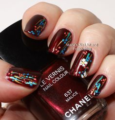 The base color is the gorgeous Chanel Malice 637 from the Holiday coll. 2012. With acrylic craft colors she painted stripes, dots and a little flower, top coat is Seche Vite.
