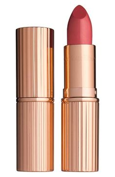 Free shipping and returns on Charlotte Tilbury 'K.I.S.S.I.N.G' Lipstick at Nordstrom.com. K.I.S.S.I.N.G Lipstick by Charlotte Tilbury gives you perfect, full, kissable lips brushed with gorgeous color. It's enriched with the Lipstick Tree, an antioxidant that naturally protects your lips from UV damage and external pollution, leaving them cashmere soft and irresistible. A special blend of waxes and light-diffusing pigments gives you a full-bodied, brilliant finish that ensures you leave a…