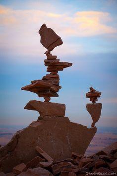 gravity glue! Check out this guy's balancing skills!