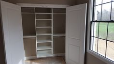 White melamine reach-in closet with double hang and adjustable shelving.