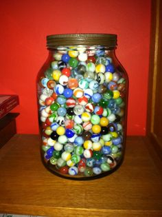 Jar of marbles from the 1950s. We played marbles a lot!  the big quartz ones were the best...but it was fun just to look at all of them!