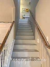 gray stairs with white risers - Google Search Laminate Stairs, Grey Laminate, Beige Carpet, New Carpet, White Stair Risers, Beach Stairs, Pergo Outlast, Stair Nosing, Painted Stairs