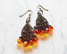 $27.50 Guns A-Blazing  Gunmetal Drop Earrings with Swarovski Fire Opal Beads by BlueWorldTreasures.etsy.com Use #discountcode PIN10 for 10% off in my store