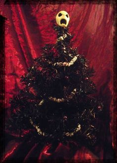 looking for a more gothic christmas this year check out some of the darker gothic christmas decor and party supplies available and get some twisted gothic