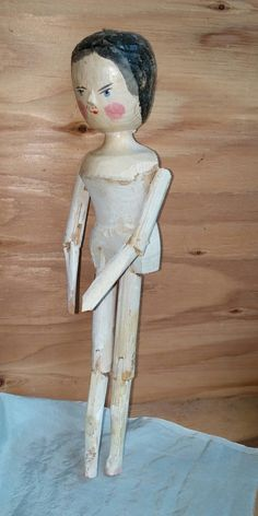 Antique Folk Art Carved Wooden Doll Grodner Tal Peg Jointed Doll Circa 1880s 11 inch. She is a sturdy example of fine wood craftsmanship from the