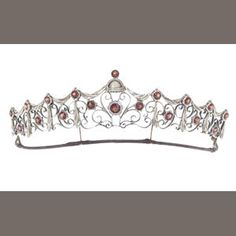 A silver gilt and garnet tiara, by Child & Child, (illustrated inside the front cover) Estimate: